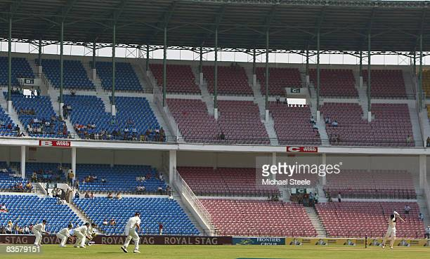 Murali Vijay of India plays off the back foot in front of a near empty stadium during day one of the Fourth Test match between India and Australia at...