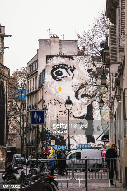 murals and people in paris, france - salvador dalí stock pictures, royalty-free photos & images