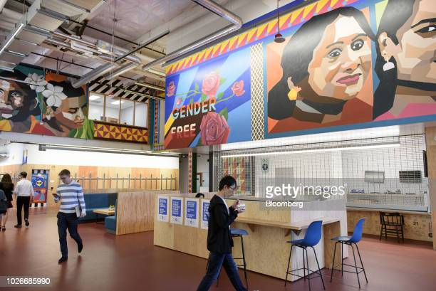 Murals are displayed in a common area at the new Facebook Inc. Frank Gehry-designed MPK 21 office building in Menlo Park, California, U.S., on...