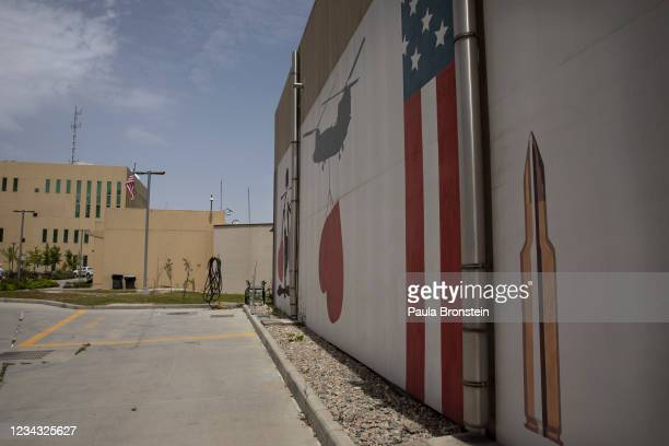 Murals are seen along the walls at the US embassy on July 30, 2021 in Kabul, Afghanistan. More than 200 Afghan nationals who assisted American troops...