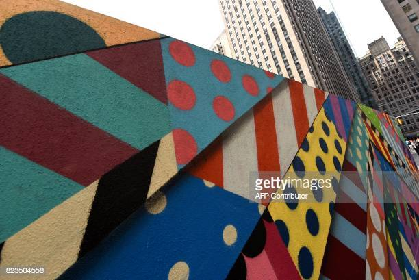 Murals by artists Jason Woodside and JM Rizzi are seen on display at the center of Rockefeller Plaza on July 27 2017 The three adjoining graffiti...