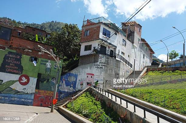 Murals depicting tpast and present times in the slums seen on a wall in the urban spaces constructed near Spain Library built for the cultural and...