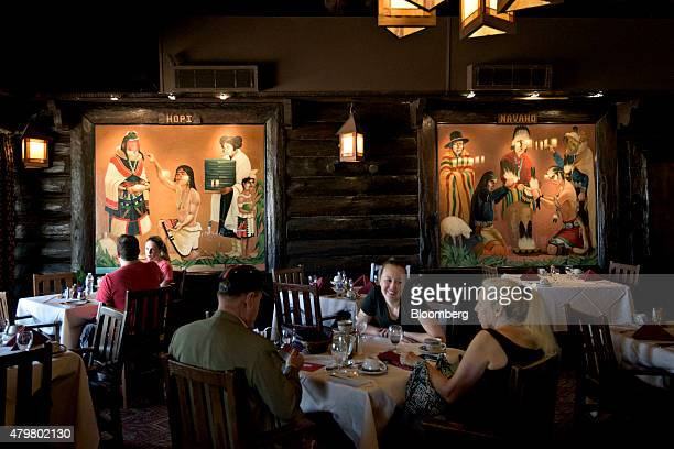 Murals depicting two Native American Tribes the Hopi and the Navajo hang on the walls as visitors eat in the dining room of the El Tovar Hotel in the...