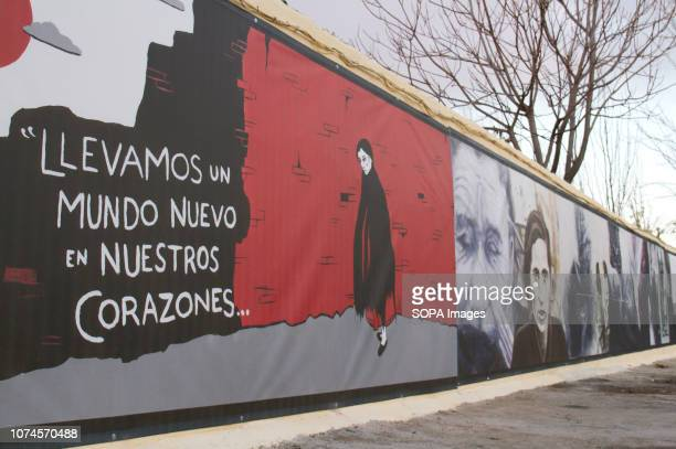 Murals seen in Robert Capa Photographer Square, with a written word saying, we carry a new world in our hearts. In 1936 Robert Capa took an iconic...