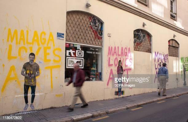 Murals with graffiti of Spanish actor Antonio Banderas actress and singer Marisol actor Dani Rovira and humorist 'Chiquito de la Calzada' are seen at...