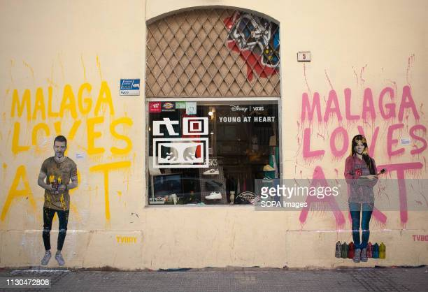 Murals with graffiti of Spanish actor Antonio Banderas and Spanish actress and singer Marisol are seen at the 'Soho' urban district in down town...
