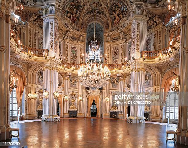 Murano chandelier and frescoes by Domenico and Giuseppe Valeriani with mythological scenes of the Triumph of Diana Central hall Stupinigi's Little...