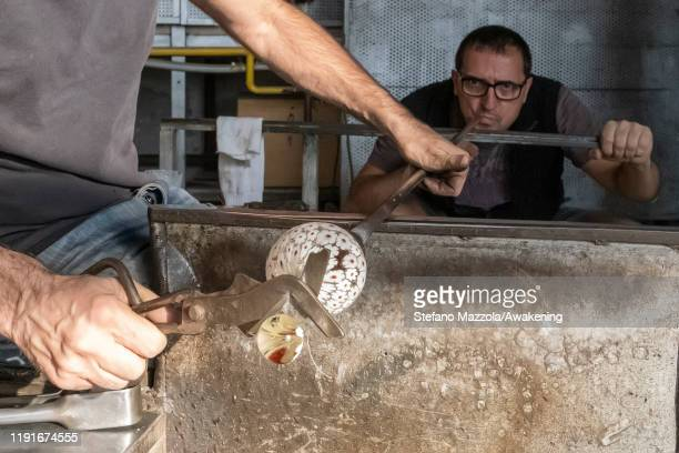 Murano glass blowers prepare Christmas decorations on December 03 2019 in Venice Italy The Antica Murano glassworks was born in 1991 in Venice on the...