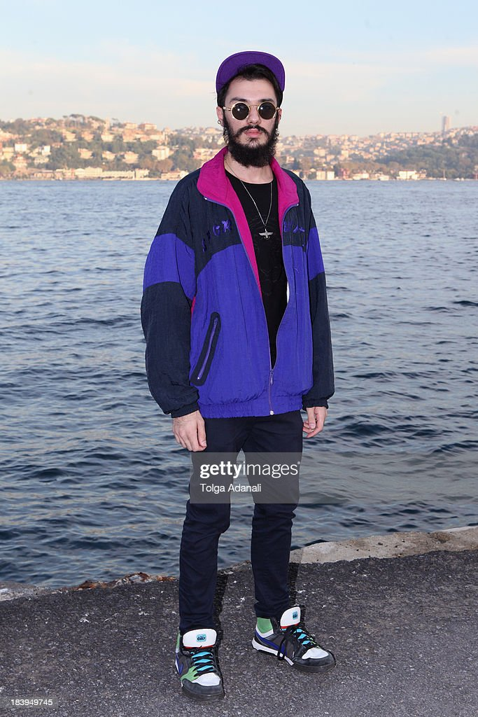 Murat Kaynum wears a Zara shirt, Topman pants, Nike shoes, vintage Puma jacket and a Boy London cap during Mercedes-Benz Fashion Week Istanbul s/s 2014 presented by American Express on October 10, 2013 in Istanbul, Turkey.
