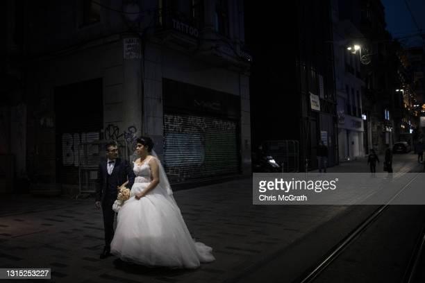 Murat Targut and wife Yasmin walk down a near empty Istiklal street to take wedding photos after the start of a three week nation wide coronavirus...