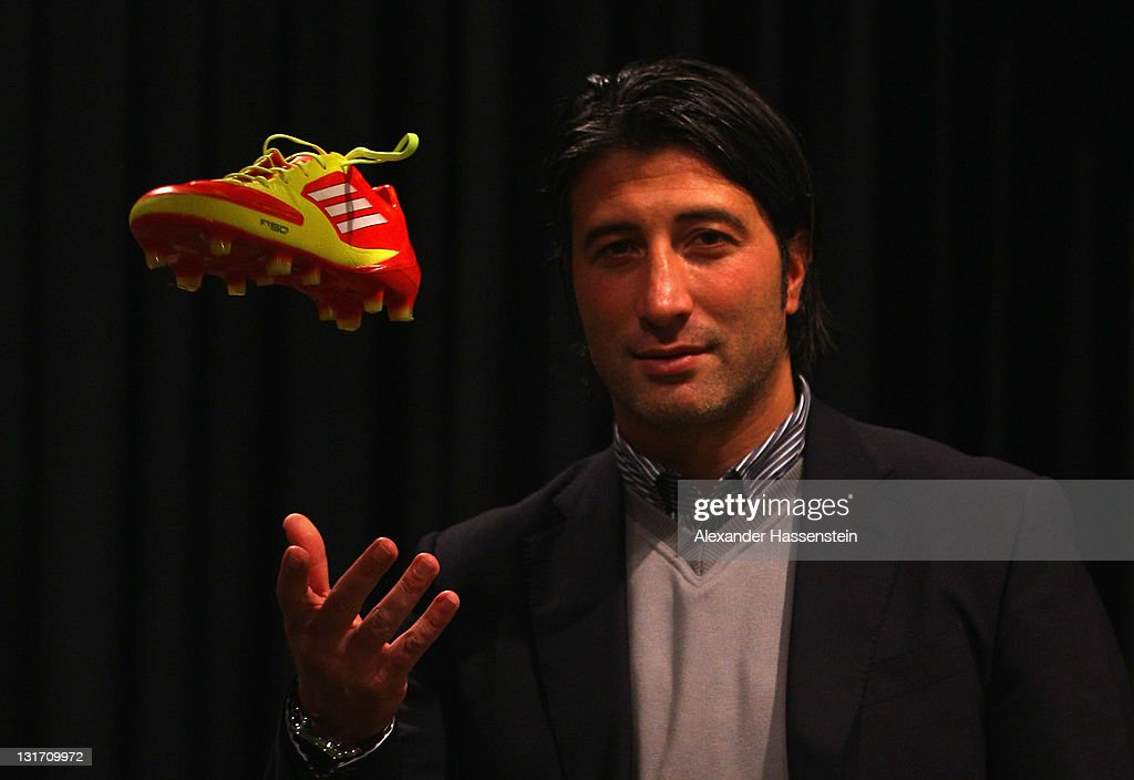 Murat Yakin, head coach of FC Luzern poses with the new adizero F50 boot during the adidas adizero F50 miCoach launch event at Miller studio on November 7, 2011 in Zurich, Switzerland.