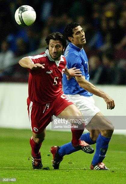 Murat Yakin of Switzerland wins the ball ahead of Bernardo Corradi of Italy during the International Friendly match held on April 30, 2003 at the...