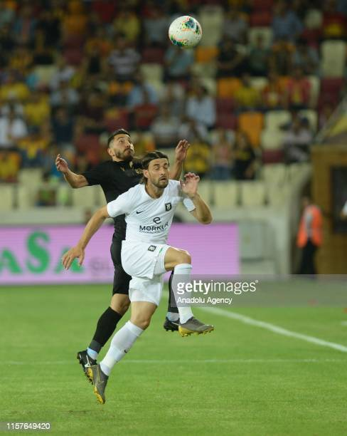 Murat Yildirim of Yeni Malatyaspor in action against Vukusic of Olimpija Ljubljana during the UEFA Europa League second qualifying match between Yeni...