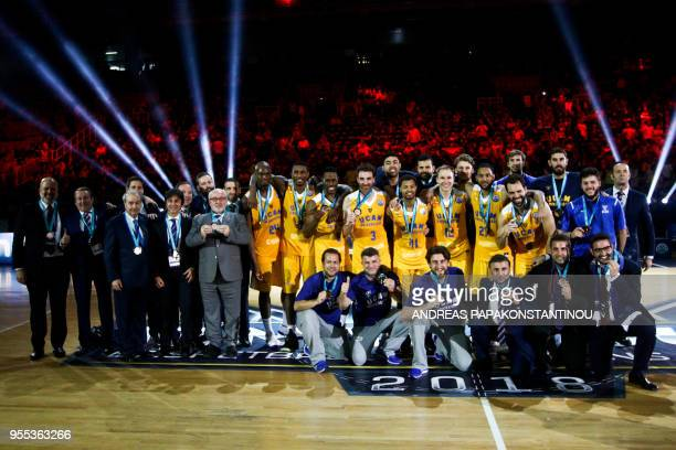 Murcia players pose for a family photo after being placed third during the Final Four Champions League basketball game between Riesen Ludwigsburg and...