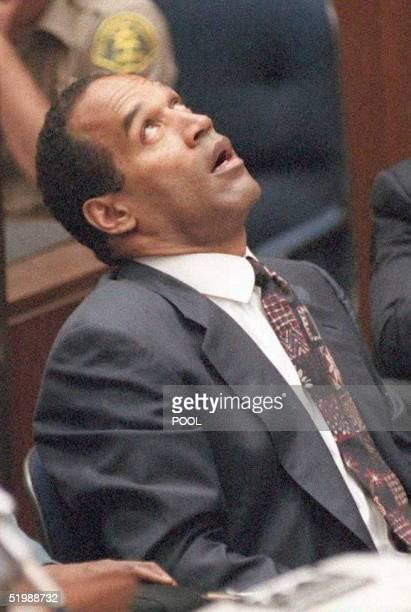 Murder defendant OJ Simpson looks up during testimony by Los Angeles County Coroner Dr Lakshmanan Sathyavagiswaran during the OJ Simpson murder trial...