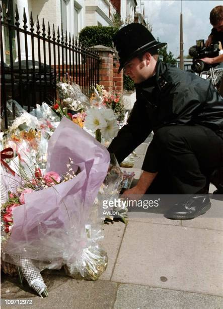Murder Of Jill Dando A policeman arranges flowers left by mourners outside the home of BBC TV Presenter Jill Dando Jill was killed with a single shot...
