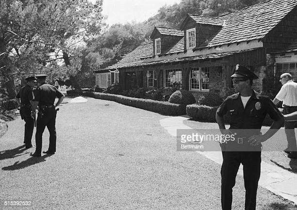 Murder Scene Los Angeles California Police guard the $200000 rented estate of movie director Roman Polanski after his wife actress Sharon Tate and...
