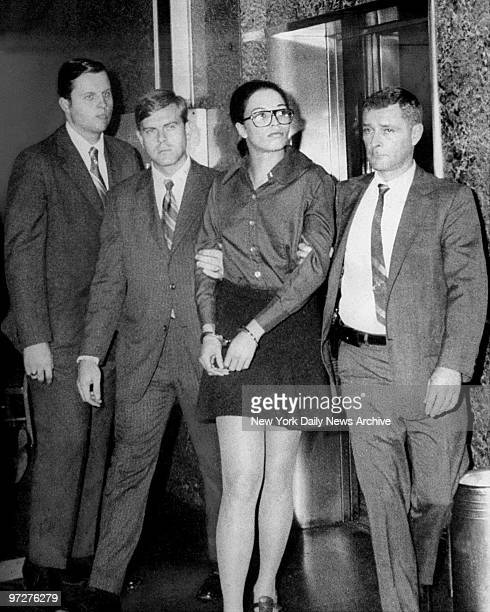 Murder suspect Angela Yvonne Davis is led by federal agents through lobby of FBI headquarters on E 69th St Angela Davis