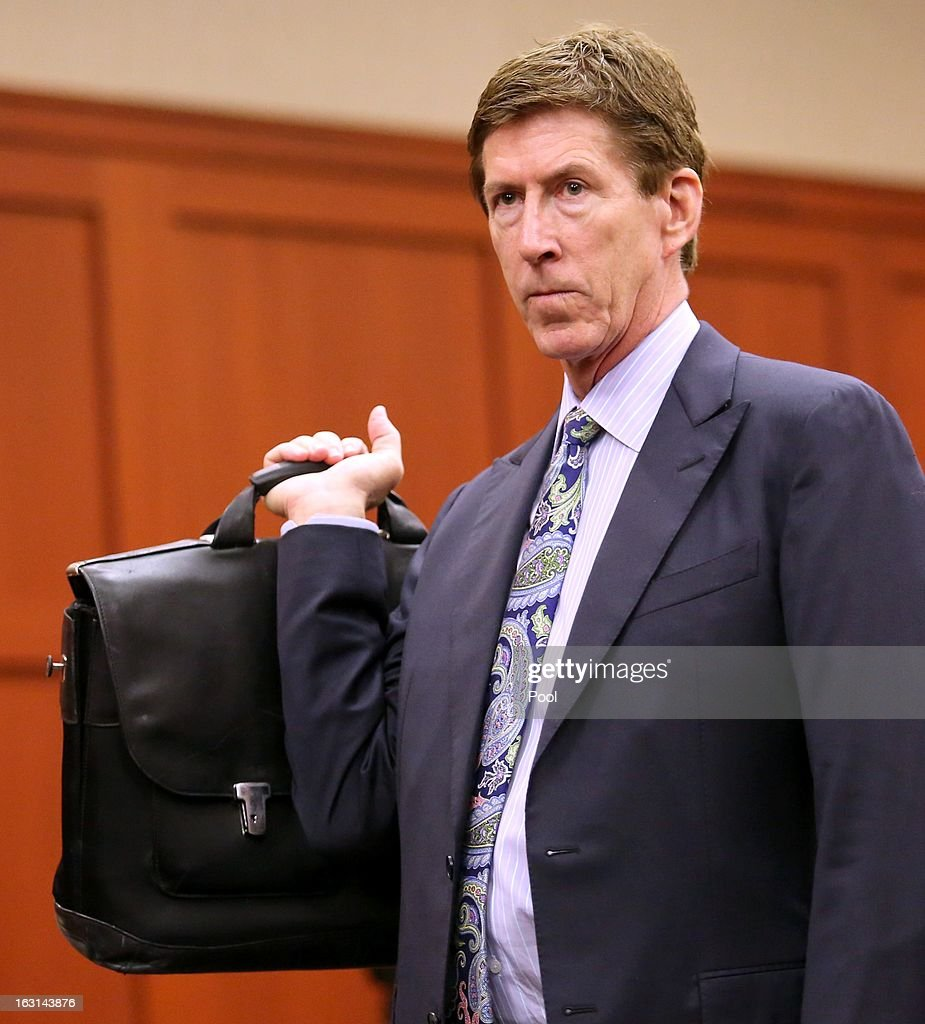 Murder suspect George Zimmerman's defense attorney Mark O'Mara appears during a status hearing in the Trayvon Martin case, in Seminole circuit court March 5, 2013 in Sanford, Florida. The defense lawyers were reportedly looking for more access to the FBI's investigation into possible civil rights violations in the shooting of Martin.