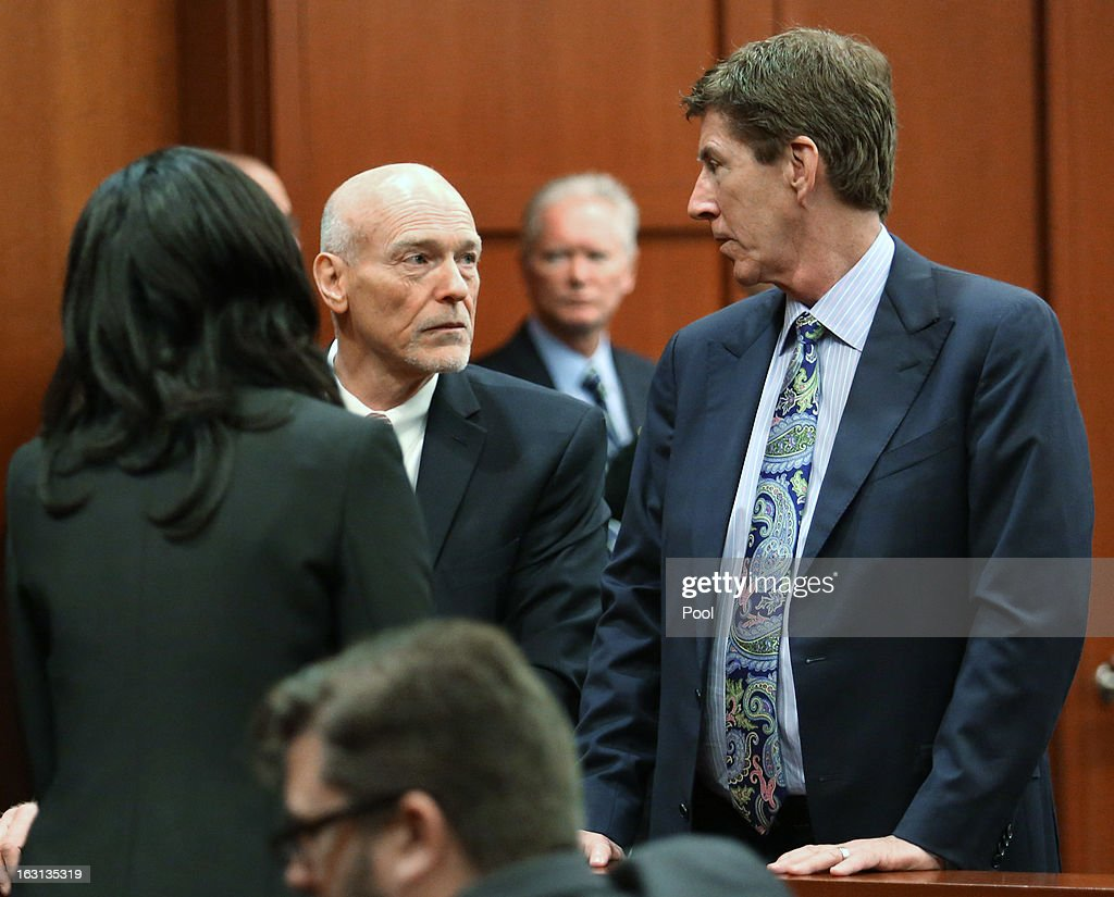 Murder suspect George Zimmerman's defense attorneys Don West (2nd L) and Mark O'Mara (R) talk during a recess at a status hearing in the Trayvon Martin case, in Seminole circuit court March 5, 2013 in Sanford, Florida. The defense lawyers were reportedly looking for more access to the FBI's investigation into possible civil rights violations in the shooting of Martin.