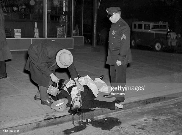Murder victim David Beadle also known as David the Beetle in front of Spot Beer Tavern in Manhattan with a policeman and crime photographer Weegee