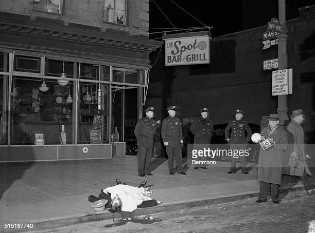 Murder victim David Beadle also known as David the Beetle in front of Spot Beer Tavern in Manhattan with policemen and crime photographer Weegee