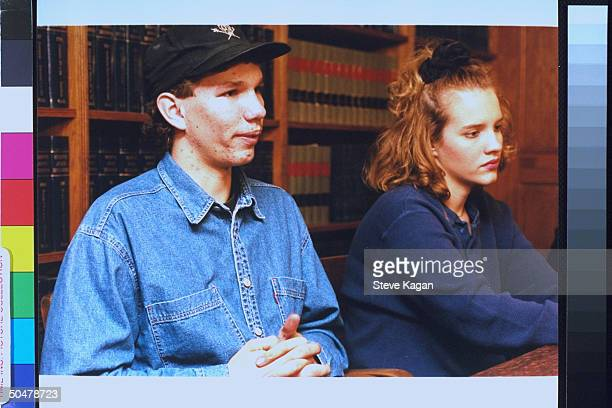 Murder victim's kids Chuck and Brook Borchardt sitting at table in lawyer's office their stepmother Diane hired 3 teens to kill their father Ruben...