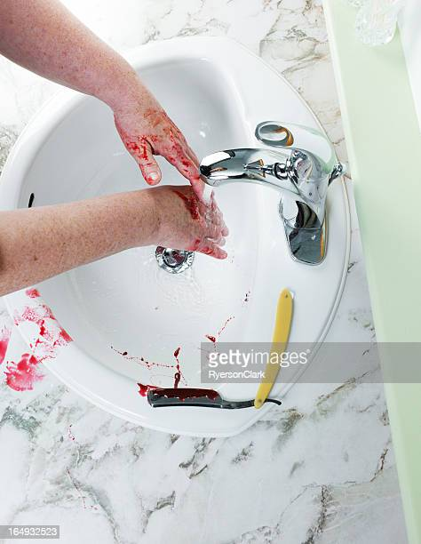 murder with an antique straight razor, washing hands - blood in sink stock pictures, royalty-free photos & images