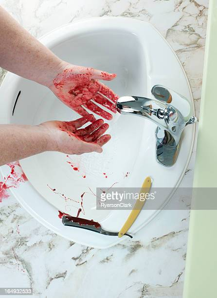 murder with an antique straight razor, washing hands. - bloody arm stock photos and pictures