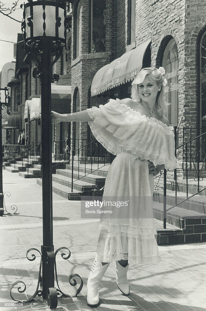Apparent tragic victim of a despondent husband's jealousy; Dorothy Stratten; Vancouver girl who was chosen 1980's Playmate of the Year; was all smiles - and her perfect body was well covered - when she posed for this photo on Yorkville Ave. in Toronto for The Star earlier this year.