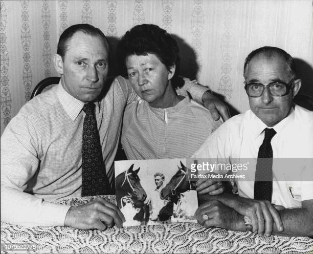 Murdered racehorse trainers family Left to R Allan Brown Jean O'Leary and husband Allan Holding a photo of George Brown April 10 1984