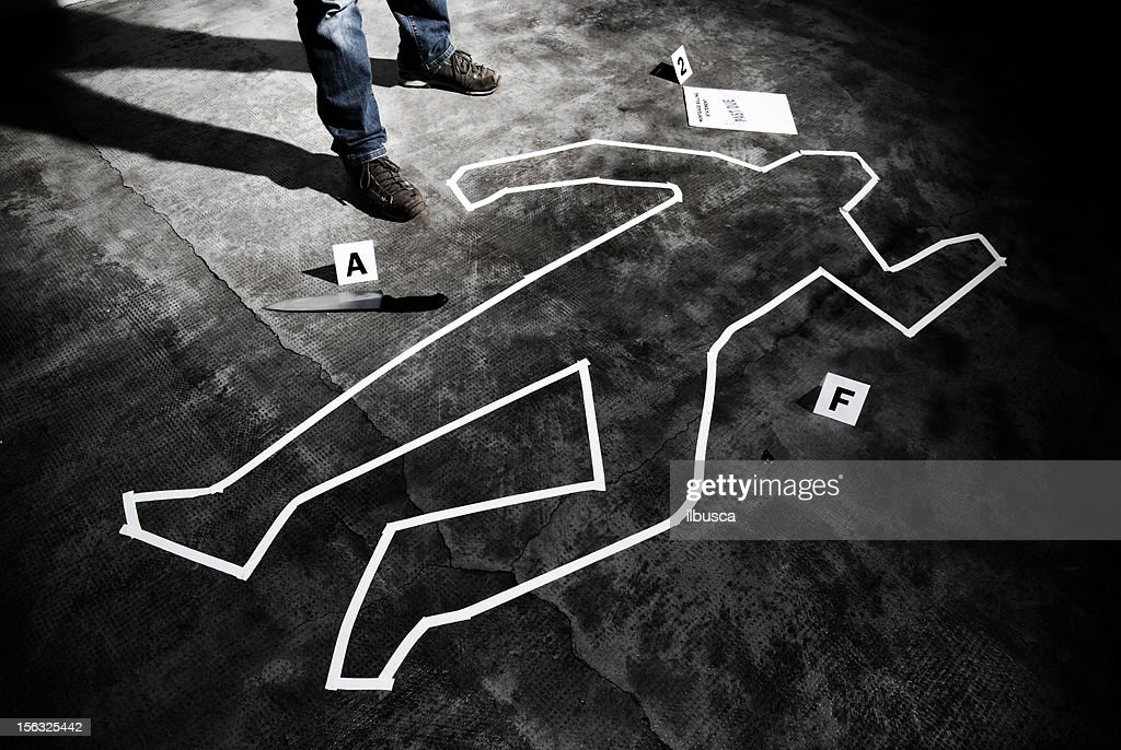 Murderer back on the crime scene : Stock Photo
