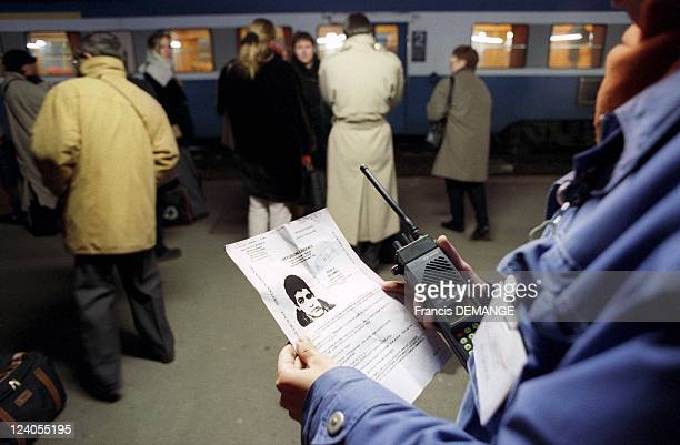 Murders in French trains An SNCF agent Holding Portrait of suspect Sid Ahmed Rezala In Dijon France On December 16 1999