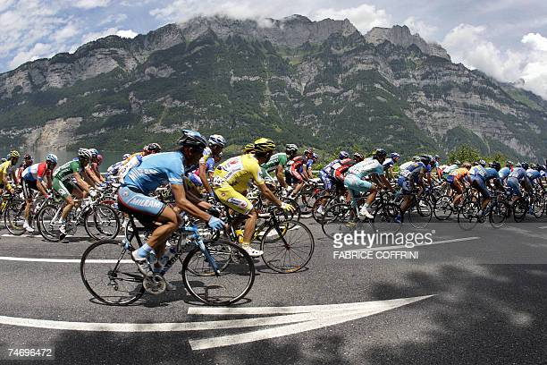 The pack rides under the Churfirsten mountains near Murg during the 71st Tour de Suisse UCI protour cycling race's third stage between Brunnen and...
