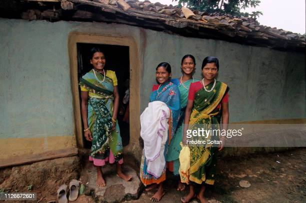 Muria People in Chhattisgarh State Young Muria at the entrance of a gothul a dormitory where boys and girls sleep work mingle and experiment with sex...
