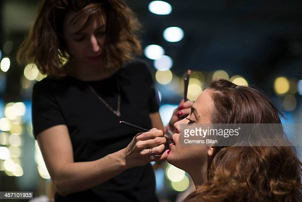Muriel Baumeister is getting make up during a shoot for AMREF in Salon Shan Rahimkhan on December 16 2013 in Berlin Germany