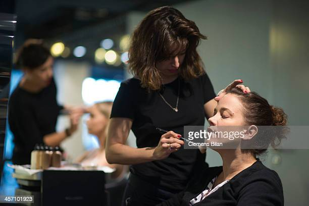 Muriel Baumeister is getting make up during a shooting for AMREF in Salon Shan Rahimkhan on December 16, 2013 in Berlin, Germany.