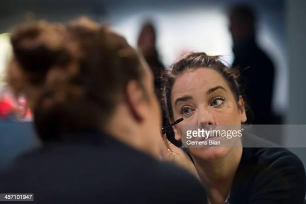 Muriel Baumeister is preparing make up during a shoot for AMREF in Salon Shan Rahimkhan on December 16, 2013 in Berlin, Germany.