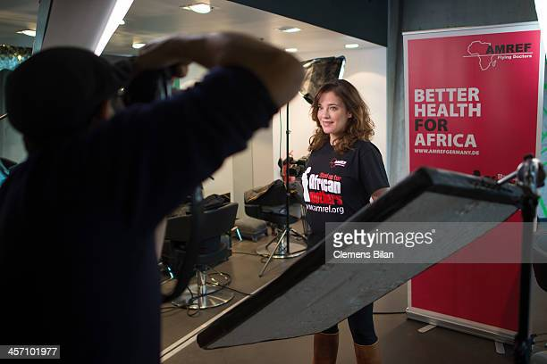 Muriel Baumeister poses during a shoot for AMREF in Salon Shan Rahimkhan on December 16 2013 in Berlin Germany