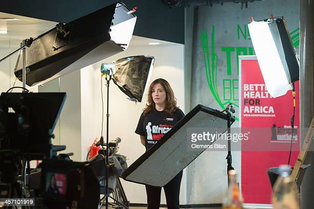 Muriel Baumeister stands near lights during a shoot for AMREF in salon Shan Rahimkhan on December 16 2013 in Berlin Germany