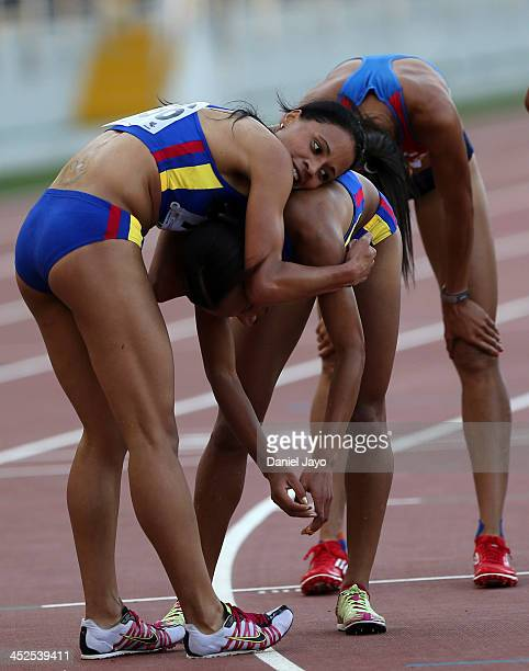 Muriel Coneo of Colombia gold medal is congratulated by teammate Angela Figueroa silver medal at the end of women's 3000 mts steeplechase as part of...