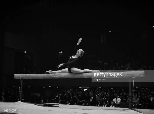 Muriel Davis-Grossfeld of the United States performs on the beam during the Women's artistic team all-around gymnastic competition on 21st October...