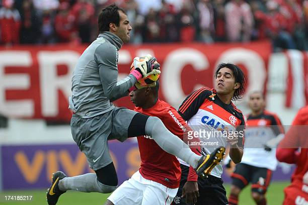 Muriel goalkeeper of Internacional jumps for the ball with Marcelo Moreno of Flamengo during a match between Flamengo and Internacional as part of...