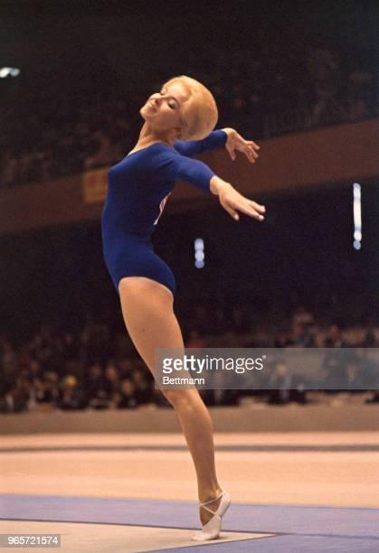 Muriel Grossfeld of U.S. Shows form in the women's gymnastics event, individual standing.