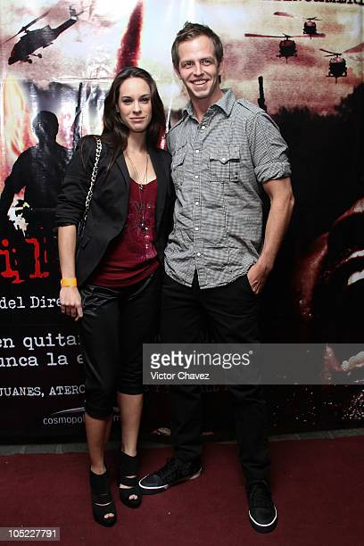 Muriel Hernandez and Molotov lead singer Randy Ebright attend the La Milagrosa premiere at Lumier Reforma on October 12 2010 in Mexico City Mexico