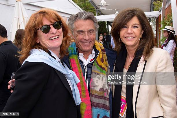 Muriel Mayette Gerard Holtz and Framboise Holtz attend the 2015 Roland Garros French Tennis Open Day Five on May 26 2015 in Paris France