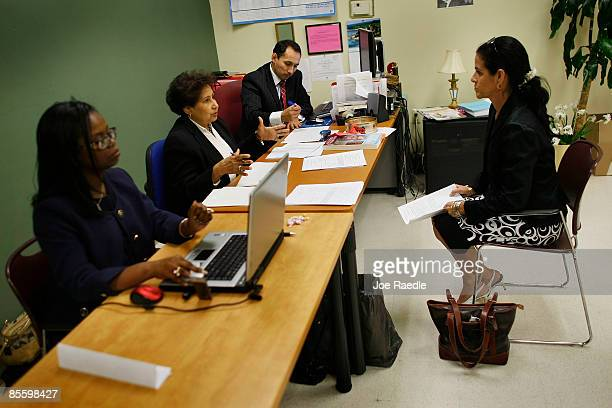 Muriel Odige sits across the table from Teresa Grant Maritza Cedeno and Juan Hernandez as they interview her for one of fifty positions open with...