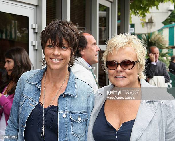 Muriel Robin and and a guest arrive at 'Le Village' during the 2009 French Tennis Open at Roland Garros arena on May 28 2009 in Paris France