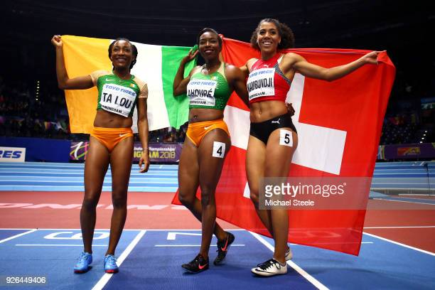 Murielle Ahoure MarieJosee Ta Lou of Cote D'Ivoire and Mujinga Kambundji of Switzerland celebrates after the 60 Metres Womens Final during the IAAF...