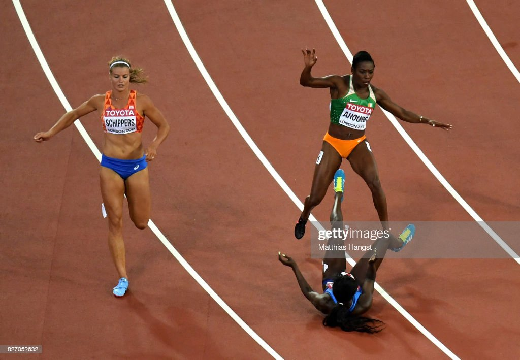 Murielle Ahoure of the Ivory Coast falls over Tori Bowie of the United States after Bowie won gold in the Women's 100 Metres Final during day three of the 16th IAAF World Athletics Championships London 2017 at The London Stadium on August 6, 2017 in London, United Kingdom.